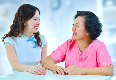 caregiver and old woman having a conversation
