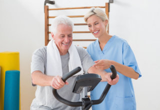 old man having his physical therapy with the assistance of therapist